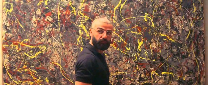 Nathan in front of what may or may not be a Jackson Pollock Painting